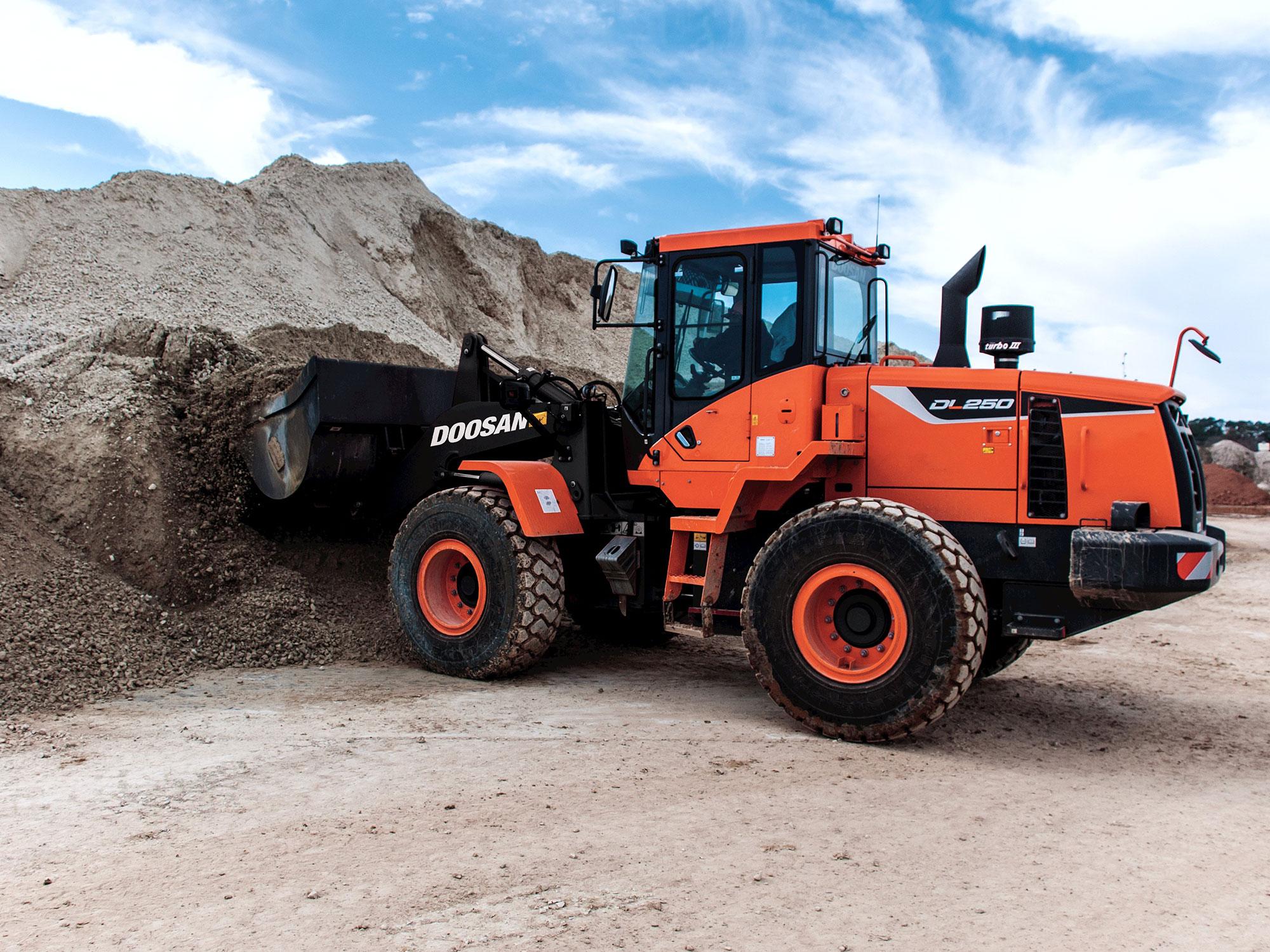 Wheel Loader digging up sand